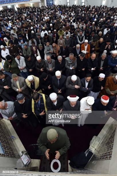 Sheikh Yahya Safi imam of the Lekamba mosque leads an Eid alFitr prayer at the Lekamba mosque in western Sydney on June 25 2017 Australian Muslims...