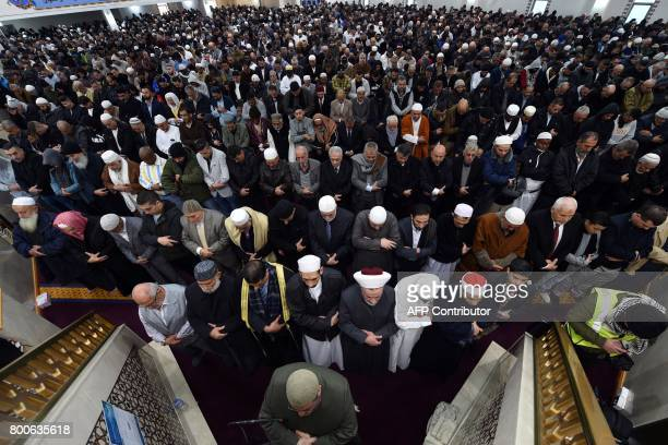 Sheikh Yahya Safi imam of the Lekamba mosque leads an Eid alFitr prayer at the Lekamba mosque in western Sydney on June 25 2017 Australian Muslims...