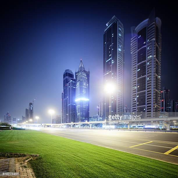 Sheikh Zayed Road traffic with green grass - Dubai