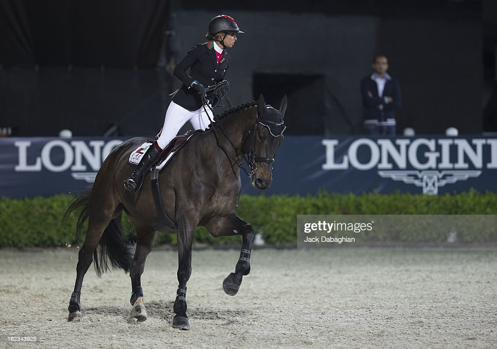 Sheikha Latifa Bint Al Maktoum of the UAE rides Peanuts de Beaufour during the President of the UAE Showjumping Cup - Furusyiah Nations Cup Series presented by Longines on February 21, 2013 in Al Ain, United Arab Emirates.