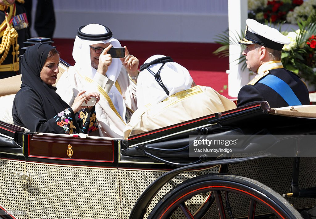 Sheikha Lubna Al-Qasimi, UAE Minister of Foreign Trade, (L) and Anwar Mohammed Gargash, UAE Minister of State for Foreign Affairs, (2L) photograph Prince Andrew, Duke of York using iPhones as they travel in a horse drawn carriage to Windsor Castle after attending the Ceremonial Welcome for UAE President, His Highness Sheikh Khalifa bin Zayed Al Nahyan on April 30, 2013 in Windsor, England. President Sheikh Khalifa begins a State visit to the UK today, the first for a UAE President in 24 years. Sheikh Khalifa will meet the British Prime Minister David Cameron tomorrow at his Downing Street residence.