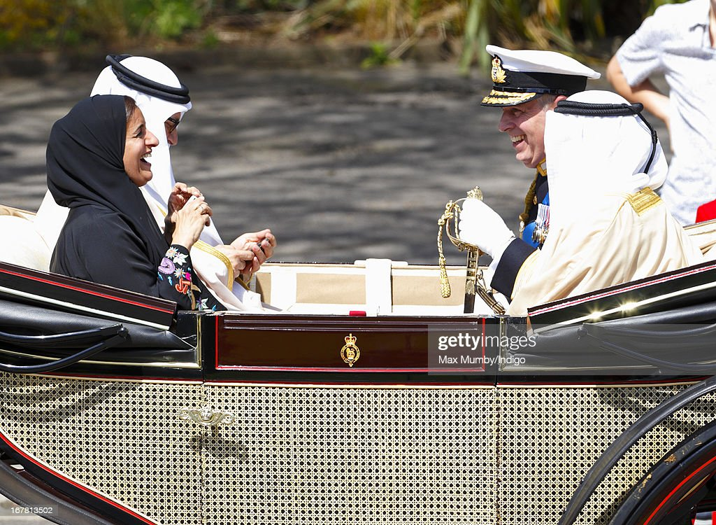 Sheikha Lubna Al-Qasimi, UAE Minister of Foreign Trade, photographs Prince Andrew, Duke of York using an iPhone as they travel in a horse drawn carriage to Windsor Castle after attending the Ceremonial Welcome for UAE President, His Highness Sheikh Khalifa bin Zayed Al Nahyan on April 30, 2013 in Windsor, England. President Sheikh Khalifa begins a State visit to the UK today, the first for a UAE President in 24 years. Sheikh Khalifa will meet the British Prime Minister David Cameron tomorrow at his Downing Street residence.