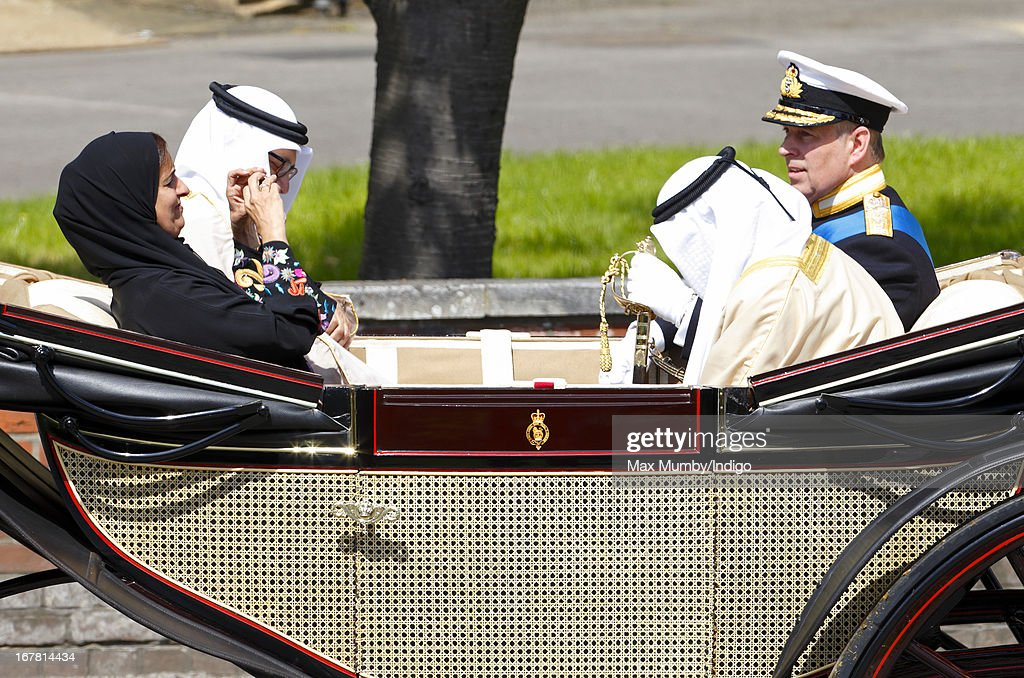 Sheikha Lubna Al-Qasimi, UAE Minister of Foreign Trade, photographs Prince Andrew, Duke of York using an iPhone as they travel in a horse drawn carriage to Windsor Castle after attending the Ceremonial Welcome for The President of the United Arab Emirates, His Highness Sheikh Khalifa bin Zayed Al Nahyan on April 30, 2013 in Windsor, England. President Sheikh Khalifa begins a State visit to the UK today, the first for a UAE President in 24 years. Sheikh Khalifa will meet the British Prime Minister David Cameron tomorrow at his Downing Street residence.
