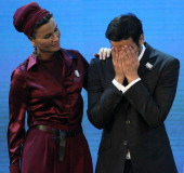 Sheikha Moza wife of Qatar's Emir Sheikh Hamad bin Khalifa alThani looks at her son Sheikh Mohammed bin Hamad alThani chairman of the Qatar 2022 bid...
