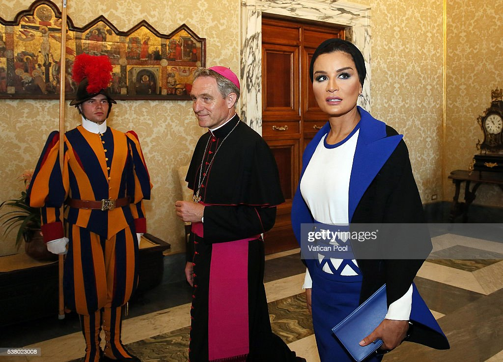 Sheikha Mozah bint Nasser Al Missned, flanked by Prefect of the Pontifical House Georg Ganswein, arrives at the Apostolic Palace for a meeting with Pope Francis on June 4, 2016 in Vatican City, Vatican. Her Highness Sheikha Moza provided information to the Holy Father on her many activities in the fields of educational and social development, at both national and international levels, and on the grave situation of schools in various areas of conflict, and received his encouragement.