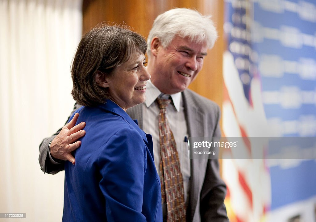 Sheila Bair, chairman of the U.S. Federal Deposit Insurance Corp., left, poses for a photograph with her husband Scott P. Cooper after giving a speech at the National Press Club in Washington, D.C., U.S., on Friday, June 24, 2011. Bair said banks will be able to meet higher capital standards with retained earnings and have 'plenty of capacity to lend.' Photographer: Joshua Roberts/Bloomberg via Getty Images
