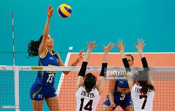 Sheila Castro of Brazil spikes the ball as Yukiko Ebata and Mai Yamaguchi of Japan defend during the match between Brazil and Japan on day 2 the FIVB...