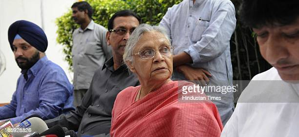 Sheila Dikshit Delhi Chief Minister along with Haroon Yusuf addresses a press conference at her residence on October 26 2013 in New Delhi India...
