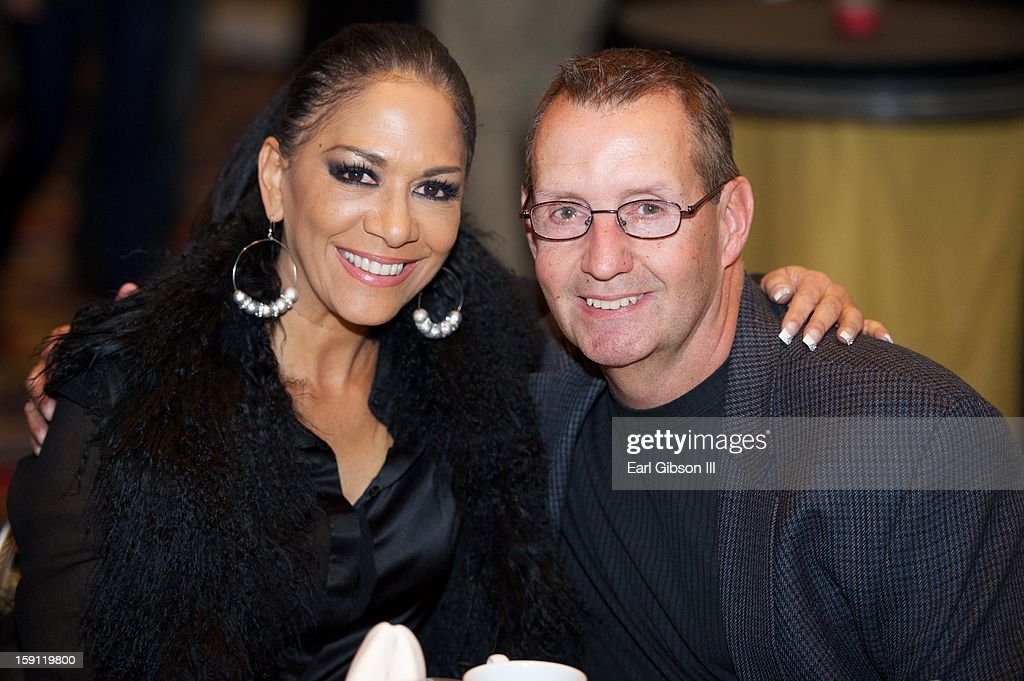 Sheila E. and Director of Sales and Marketing Tom Land attend a Monster Products Conference at the Paris Hotel on January 7, 2013 in Las Vegas, Nevada.
