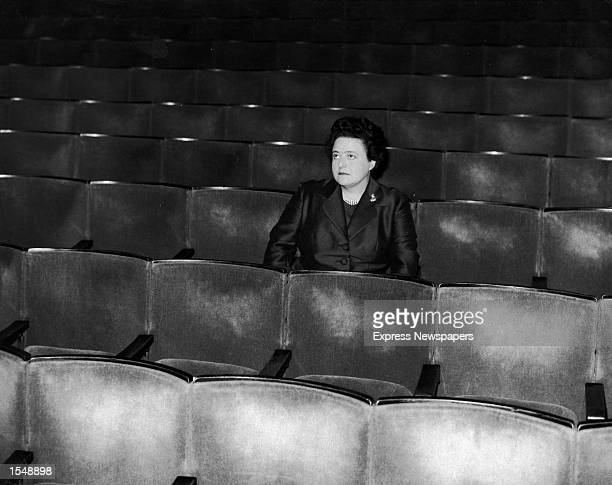 Sheila Van Damm sits in the empty seats at the Windmill Theatre London England November 2 1964