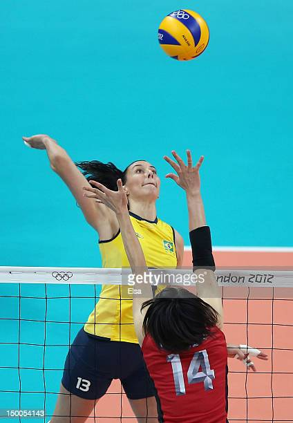 Sheilla Castro of Brazil spikes the ball as Saori Sakoda of Japan defends during the Women's Volleyball semifinal match on Day 13 of the London 2012...