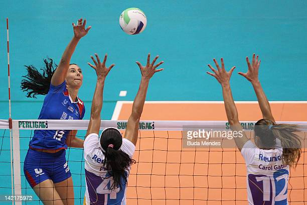 Sheilla of Unilever team in action against Paula Pequeno and Carol Gattaz of Volei Futuro team during a Women's Volleyball Super League Playoffs |...