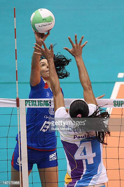 Sheilla of Unilever team in action against Paula Pequeno of Volei Futuro team during a Women's Volleyball Super League Playoffs | Semifinals at...