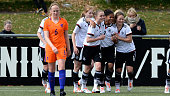 Shekiera Martinez of Germany celebrates with team mates after scoring her team's first goal during the U17 Girl's international friendly match...