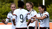 Shekiera Martinez of Germany celebrates with team mates after scoring her team's third goal during the U17 Girl's international friendly match...