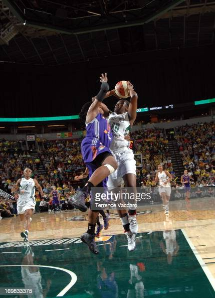 Shekinna Stricklen of the Seattle Storm shoots against Alexis Hornbuckle of the Phoenix Mercury during a WNBA game on June 2 2013 at Key Arena in...