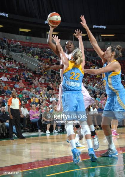 Shekinna Stricklen of the Seattle Storm shoots against Courtney Vandersloot of the Chicago Sky during the game on September 18 2012 at Key Arena in...