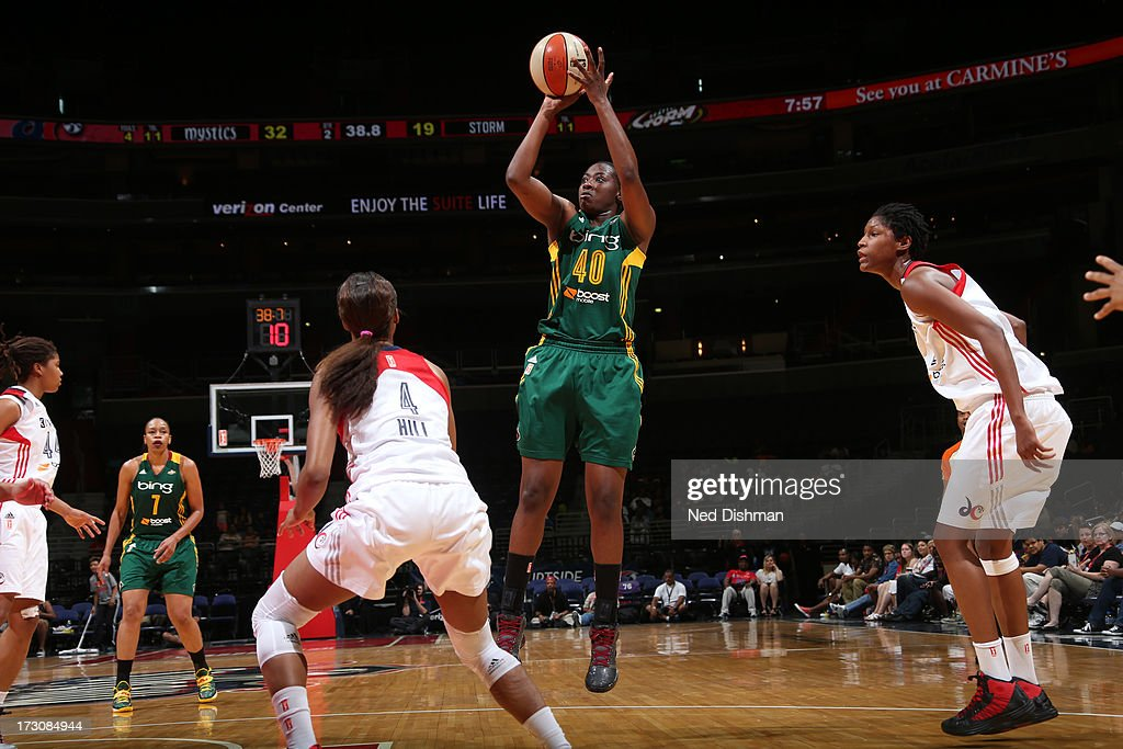 Shekinna Stricklen #40 of the Seattle Storm shoots against <a gi-track='captionPersonalityLinkClicked' href=/galleries/search?phrase=Michelle+Snow&family=editorial&specificpeople=208195 ng-click='$event.stopPropagation()'>Michelle Snow</a> #2 of the Washington Mystics at the Verizon Center on July 6, 2013 in Washington, DC.