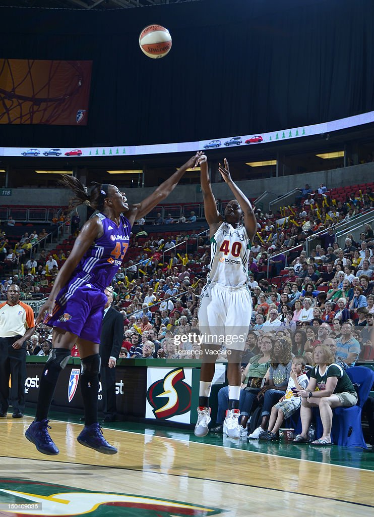 Shekinna Thompson of the Seattle Storm shoots against Nakia Sanford of the Phoenix Mercury during the game on August 16 2012 at Key Arena in Seattle...