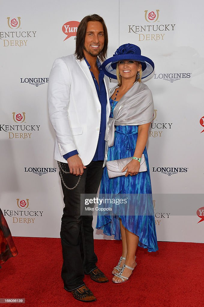 J.D. Shelburne (L) and guest celebrate the 139th Kentucky Derby with Moet & Chandon at Churchill Downs on May 4, 2013 in Louisville, Kentucky.