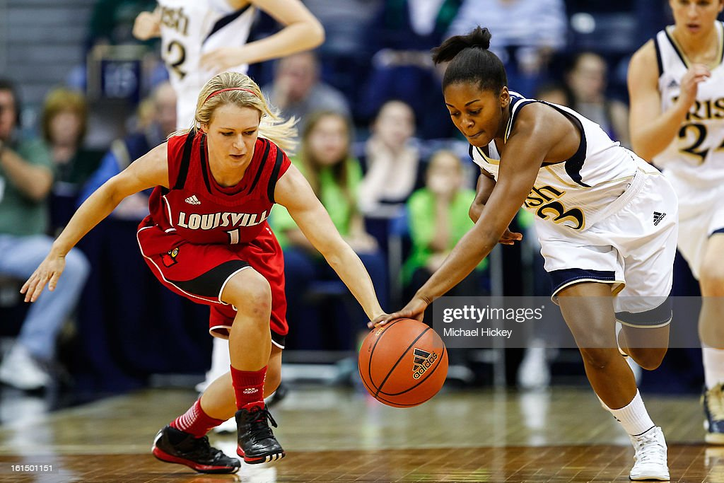 Shelby Harper #1 of the Louisville Cardinals and Whitney Holloway #3 of the Notre Dame Fighting Irish fight for a loose ball at Purcel Pavilion on February 11, 2013 in South Bend, Indiana. Notre Dame defeated Louisville 93-64.