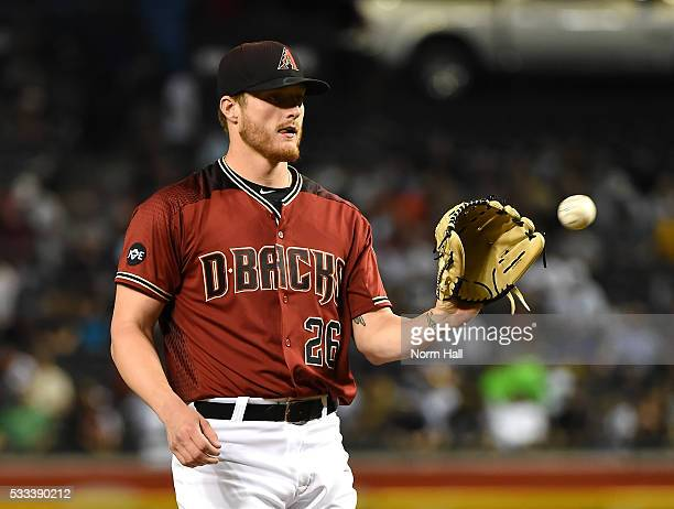 Shelby Miller of the Arizona Diamondbacks catches a throw back from home plate against the New York Yankees at Chase Field on May 18 2016 in Phoenix...