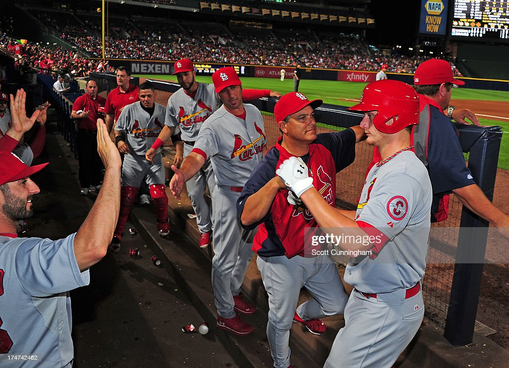 <a gi-track='captionPersonalityLinkClicked' href=/galleries/search?phrase=Shelby+Miller&family=editorial&specificpeople=4761626 ng-click='$event.stopPropagation()'>Shelby Miller</a> #40 of the St. Louis Cardinals is congratulated by teammates after scoring a fifth inning run against the Atlanta Braves at Turner Field on July 28, 2013 in Atlanta, Georgia.