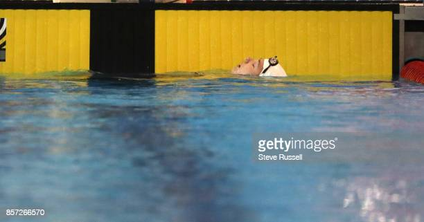 TORONTO ON OCTOBER 3 Shelby Newkirk of Canada rests after breaking the world record in the S7 100 metre backstroke in 12143 as the Paraswimming...