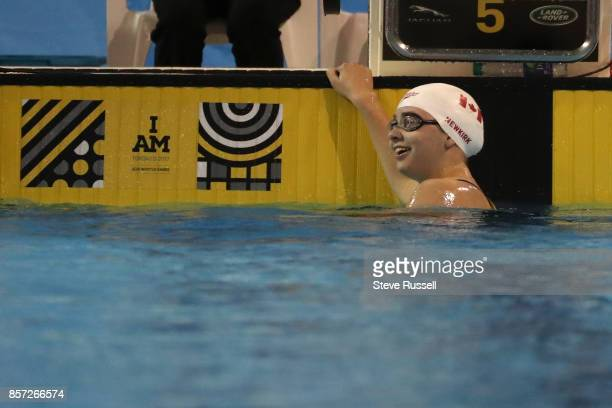 TORONTO ON OCTOBER 3 Shelby Newkirk of Canada smiles after breaking the world record in the S7 100 metre backstroke in 12143 as the Paraswimming...