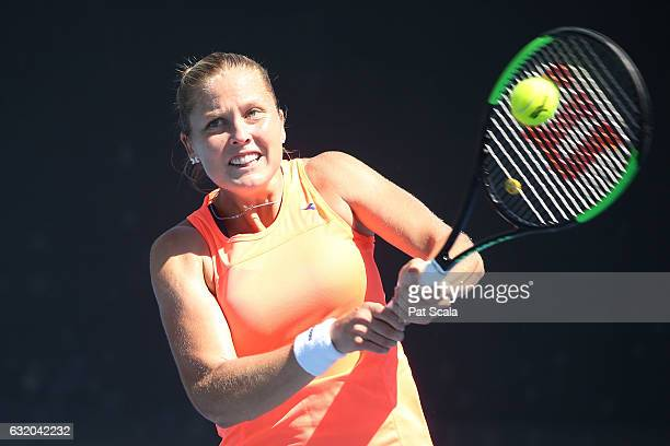 Shelby Rogers of the United States plays a backhand in her first round doubles match against Kiki Bertens of the Netherlands and Johanna Larsson of...