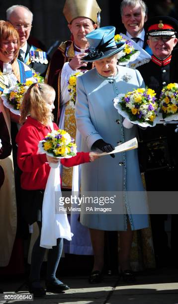 Shelby Rotherham aged 9 handing back Queen Elizabeth II's order of service after she dropped it following the Royal Maundy Service outside Derby...