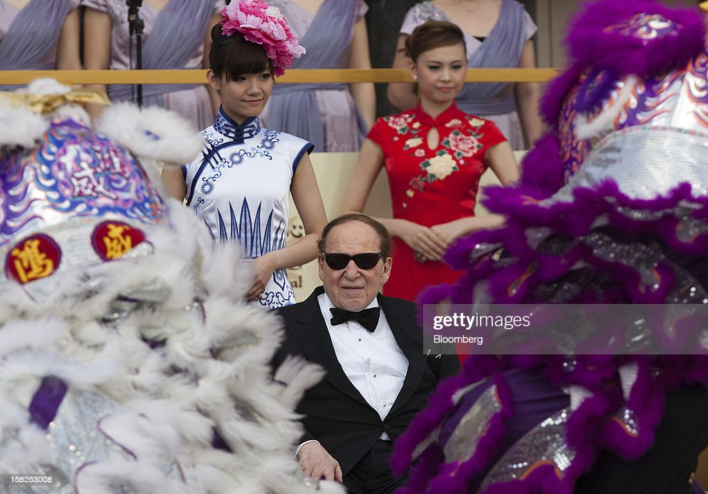 Sheldon Adelson, chairman and chief executive officer of Las Vegas Sands Corp., center, watches a traditional lion dance during the opening of the Sands Cotai Central resort in Macau, China, on Wednesday, April 11, 2012. Adelson plans to spend $35 billion on building Spanish gambling resorts over nine years and will add a new Macau location to expand globally. Photographer: Jerome Favre/Bloomberg via Getty Images