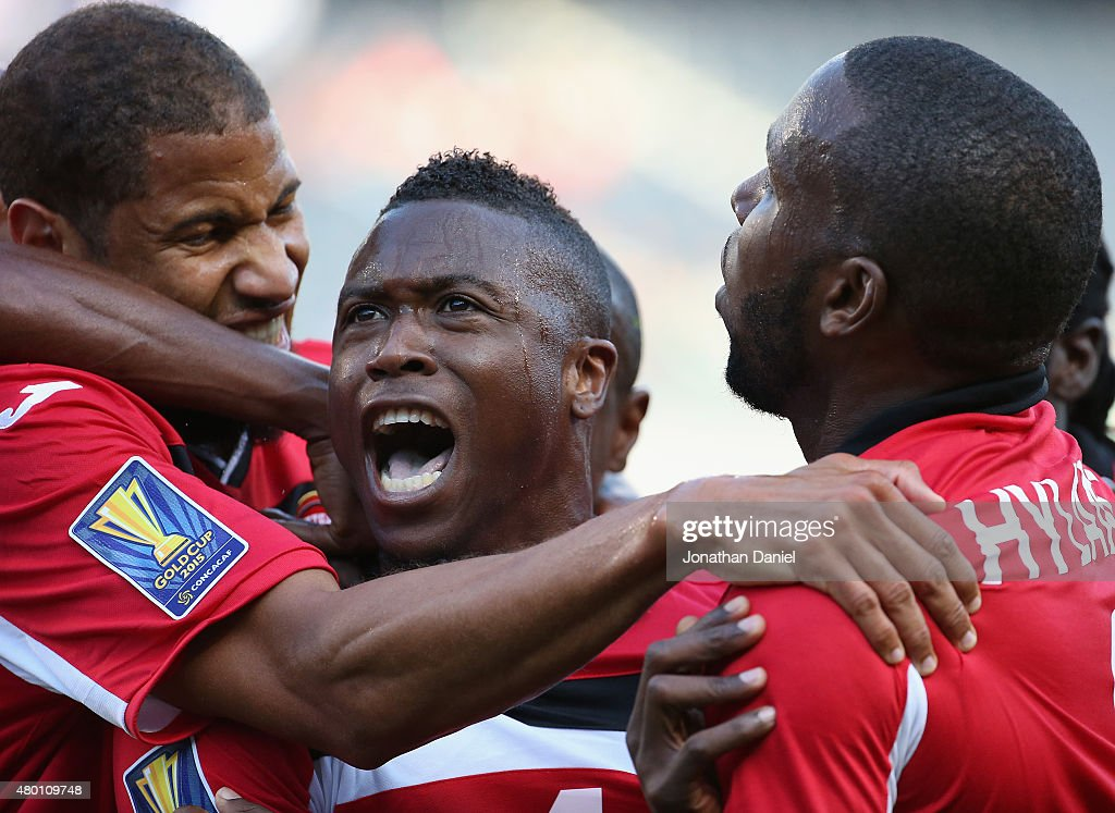 Sheldon Bateau #4 of Trinidad & Tobago (Center) celebrates a first half goal against Guatemala with teammates including Radanfah Abu Bakr #6 (L) and <a gi-track='captionPersonalityLinkClicked' href=/galleries/search?phrase=Khaleem+Hyland&family=editorial&specificpeople=5366394 ng-click='$event.stopPropagation()'>Khaleem Hyland</a> #8 (R) during a match in the 2015 CONCACAF Gold Cup at Soldier Field on July 9, 2015 in Chicago, Illinois.