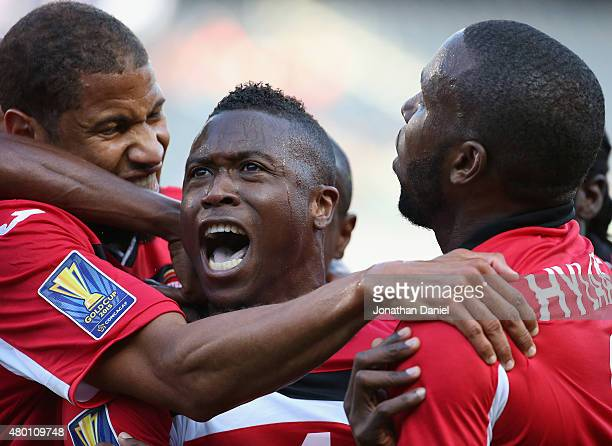 Sheldon Bateau of Trinidad Tobago celebrates a first half goal against Guatemala with teammates including Radanfah Abu Bakr and Khaleem Hyland during...