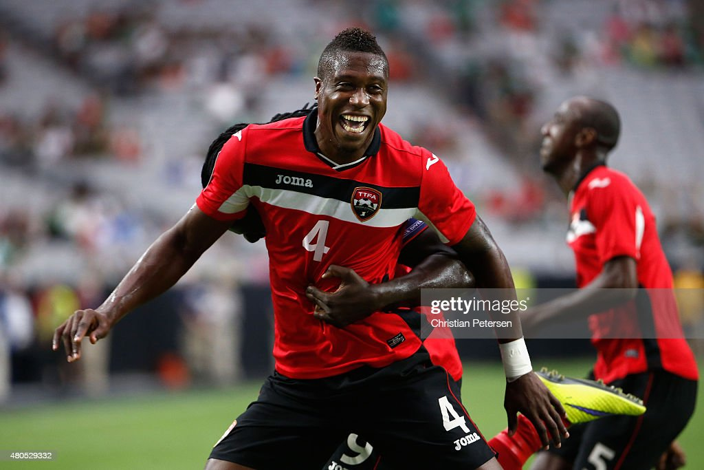 Sheldon Bateau of Trinidad Tobago celebrates after scoring a first half goal against Cuba during the 2015 CONCACAF Gold Cup group C match at...