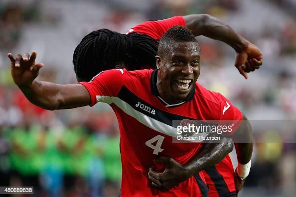 Sheldon Bateau of Trinidad Tobago celebrates alongside Kenwyne Jones after Bateau scored a first half goal against Cuba during the 2015 CONCACAF Gold...