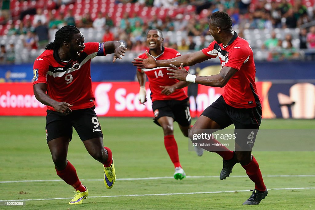 Sheldon Bateau of Trinidad Tobago celebrates with Kenwyne Jones after Bateau scored a first half goal against Cuba during the 2015 CONCACAF Gold Cup...