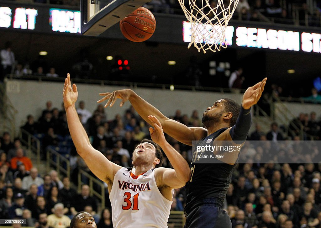 Sheldon Jeter #21 of the Pittsburgh Panthers blocks the shot of Jarred Reuter #31 of the Virginia Cavaliers during the game at Petersen Events Center on February 6, 2016 in Pittsburgh, Pennsylvania.