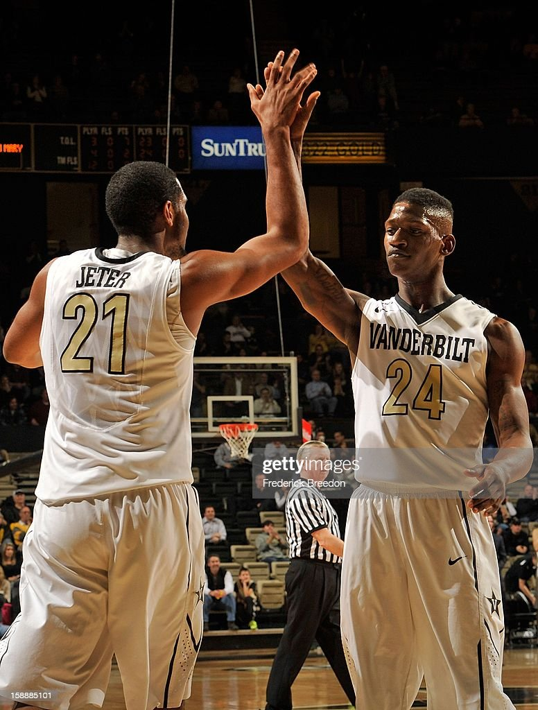 Sheldon Jeter #21 of the Vanderbilt Commodores high fives teammate Dai-Jon Parker #24 during a game against William & Mary at Memorial Gym on January 2, 2013 in Nashville, Tennessee.