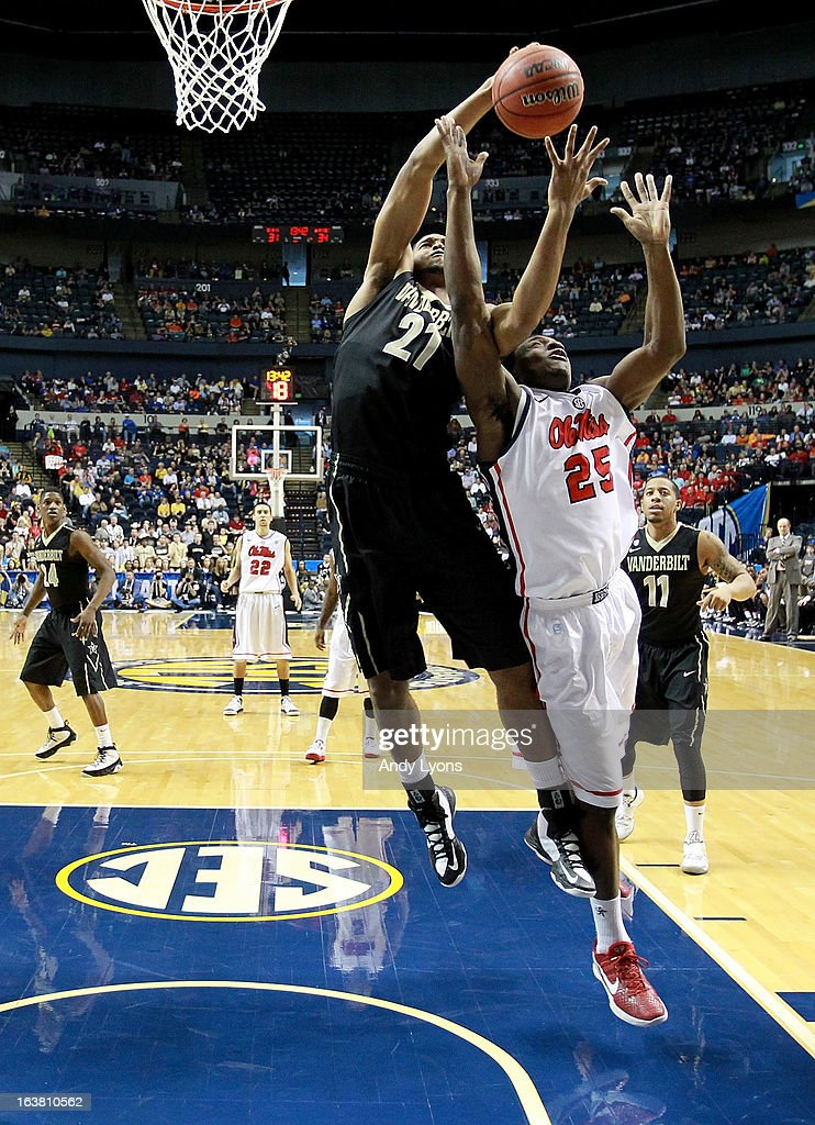 Sheldon Jeter #21 of the Vanderbilt Commodores rebounds against Terry Brutus #25 of the Ole Miss Rebels in the second half during the Semifinals of the SEC basketball tournament at Bridgestone Arena on March 16, 2013 in Nashville, Tennessee. Ole Miss won 64-52.