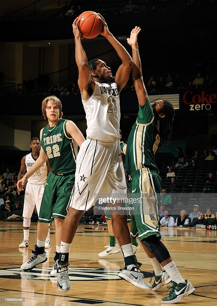 Sheldon Jeter #21 of the Vanderbilt Commodores takes a shot over Marcus Thornton #3 of William & Mary at Memorial Gym on January 2, 2013 in Nashville, Tennessee.