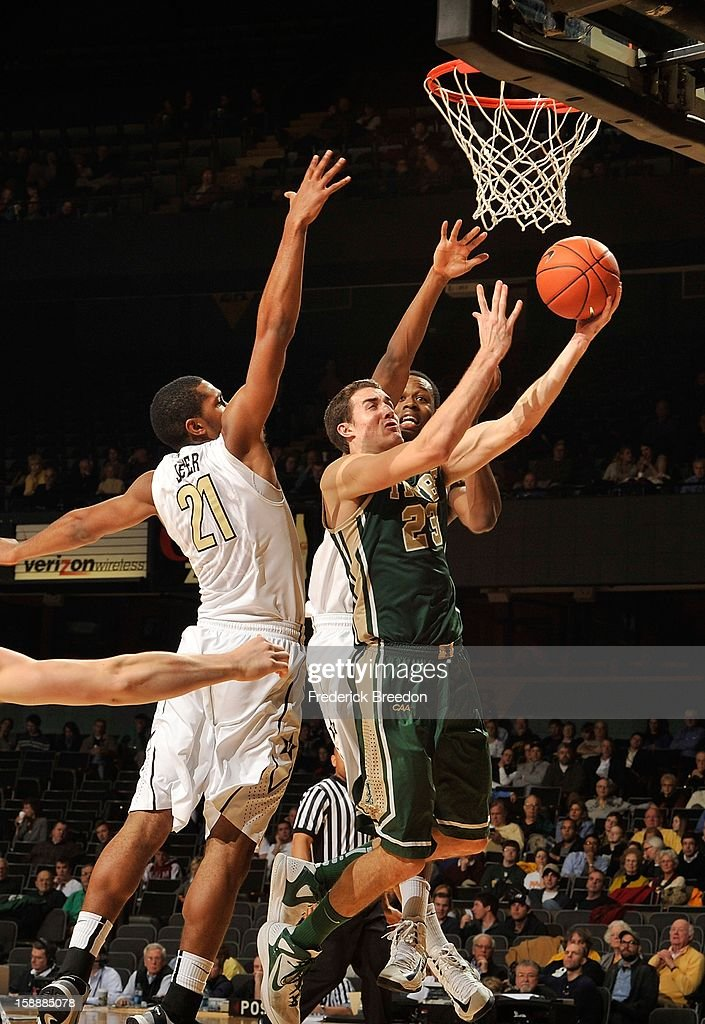 Sheldon Jeter #21 of the Vanderbilt Commodores tries to block a shot by Kyle Gaillard #23 of William & Mary at Memorial Gym on January 2, 2013 in Nashville, Tennessee.