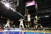 Sheldon McClellan of the Miami Hurricanes shoots the ball against Anton Grady of the Wichita State Shockers in the second half of their game during...