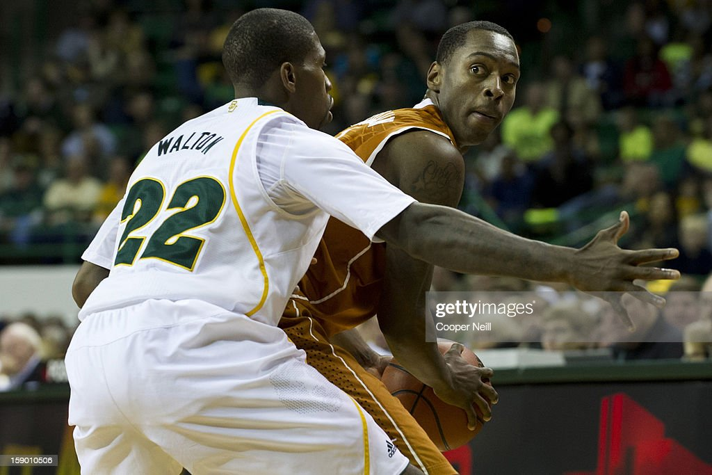Sheldon McClellan #1 of the University of Texas Longhorns is defended by A.J. Walton #22 of the Baylor University Bears on January 5, 2013 at the Ferrell Center in Waco, Texas.
