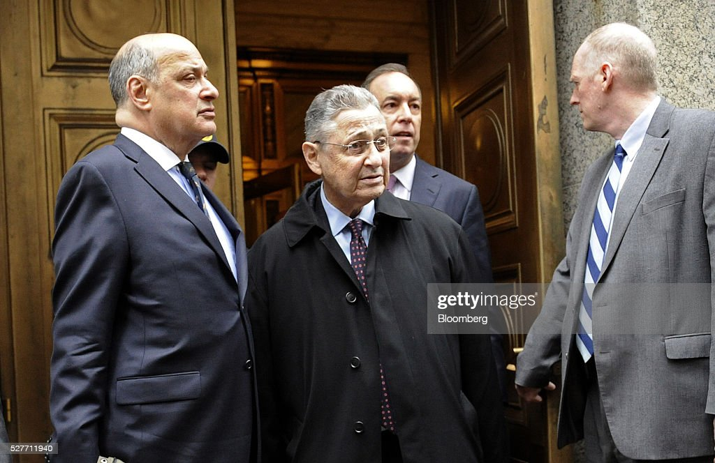 Sheldon Silver, former speaker of the New York State Assembly, center, exits federal court with his attorney Joel Cohen, left, following a sentencing hearing in New York, U.S., on Tuesday, May 3, 2016. Silver was sentenced to 12 years in prison on corruption charges. Photographer: Louis Lanzano/Bloomberg via Getty Images