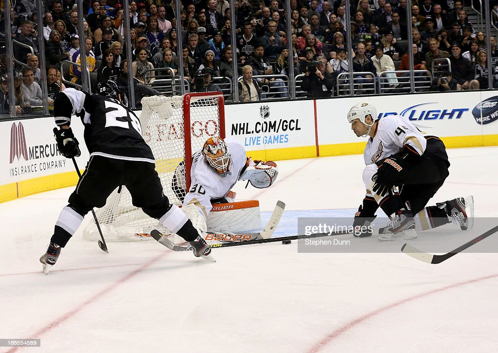 <a gi-track='captionPersonalityLinkClicked' href=/galleries/search?phrase=Sheldon+Souray&family=editorial&specificpeople=203131 ng-click='$event.stopPropagation()'>Sheldon Souray</a> #4 4 of the Anaheim Ducks blocks a pass by <a gi-track='captionPersonalityLinkClicked' href=/galleries/search?phrase=Jarret+Stoll&family=editorial&specificpeople=204632 ng-click='$event.stopPropagation()'>Jarret Stoll</a> #28 of the Los Angeles Kings in front of Ducks goalie <a gi-track='captionPersonalityLinkClicked' href=/galleries/search?phrase=Viktor+Fasth&family=editorial&specificpeople=7640136 ng-click='$event.stopPropagation()'>Viktor Fasth</a> #30 at Staples Center on April 13, 2013 in Los Angeles, California.