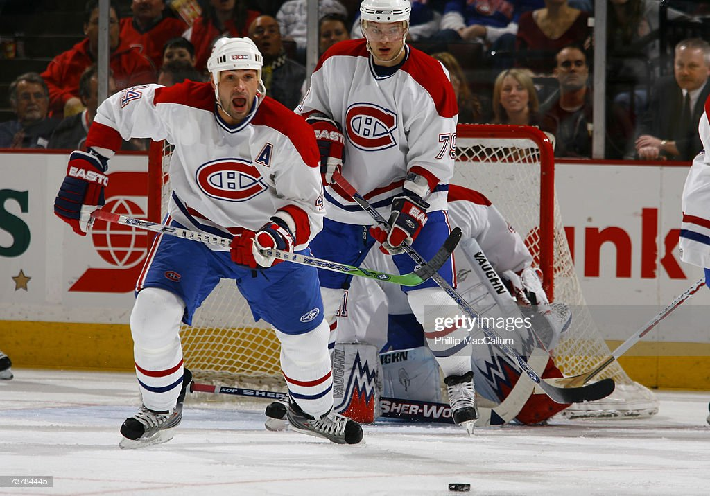 Sheldon Souray and Andrei Markov of the Montreal Canadiens protect the front of their net during a game against the Ottawa Senators on March 30 2007...