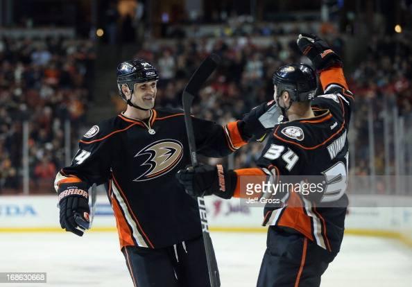 Sheldon Souray and Daniel Winnik of the Anaheim Ducks celebrate against the Calgary Flames at Honda Center on March 8 2013 in Anaheim California
