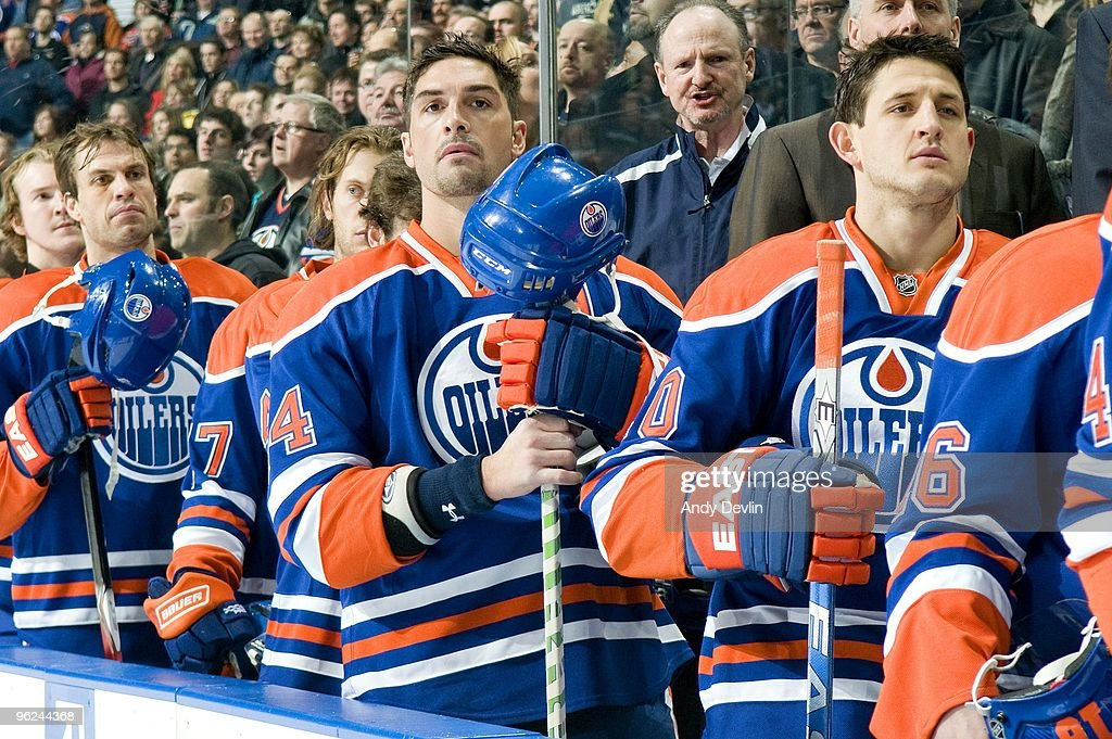 Sheldon Souray and Shawn Horcoff of the Edmonton Oilers stands for the National Anthems before a game against the Chicago Blackhawks at Rexall Place...