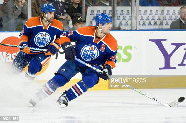 Sheldon Souray and Zack Stortini of the Edmonton Oilers turn to follow the play against the Phoenix Coyotes at Rexall Place on January 5 2010 in...